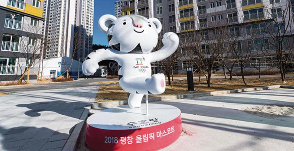 Maskotti, joka kannustaa urheilijoita olympialaisissa.